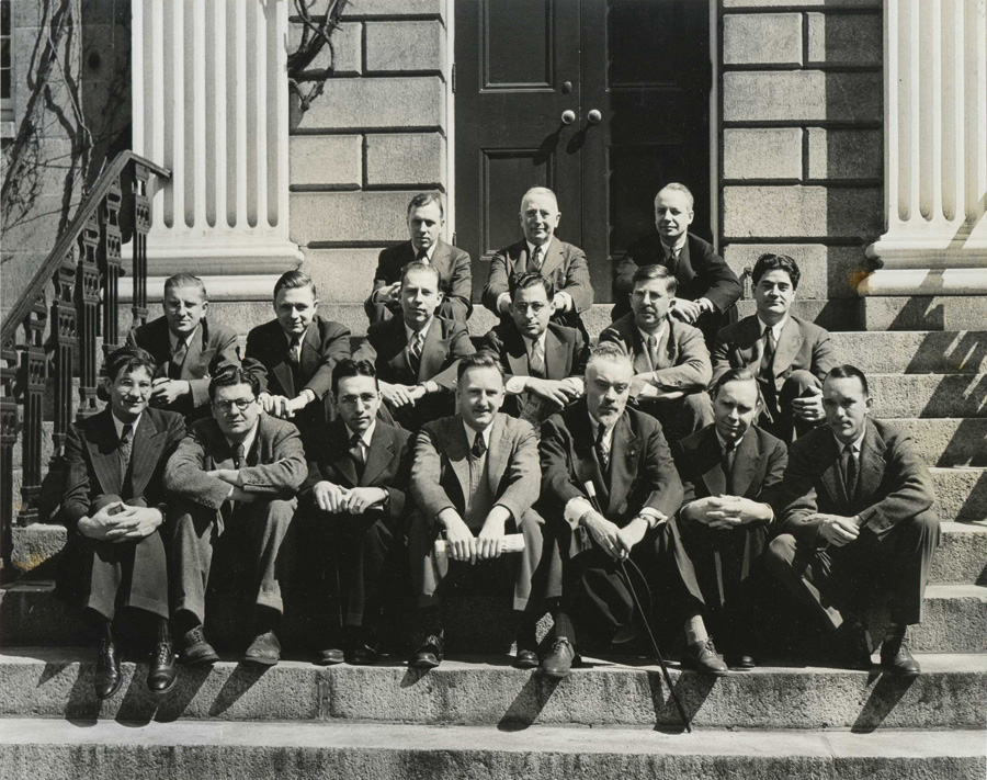 First row: Nathan Caldwell, Alexander Kendrick, George Chaplin, William Pinkerton, Lowell Limpus, Harry Montgomery, John Crider. Second row: Ralph Werner, Boyd Simmons, Vance Johnson, Harry Davis, Arthur Eggleston, William Miller. Third row: Louis Lyons (Curator), Jerome Greene (Harvard Corporation), Arthur Wild (Director of Harvard Public Relations). Not pictured: Charles Edmundson, Fred Vanderschmidt.